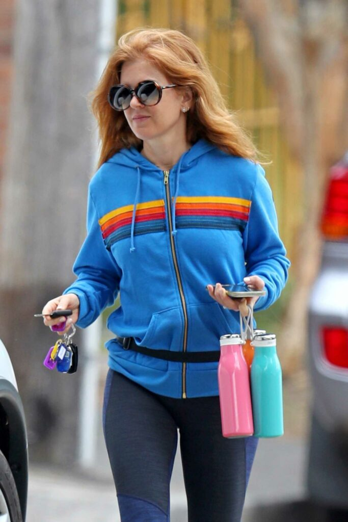 Isla Fisher in a Blue Track Jacket