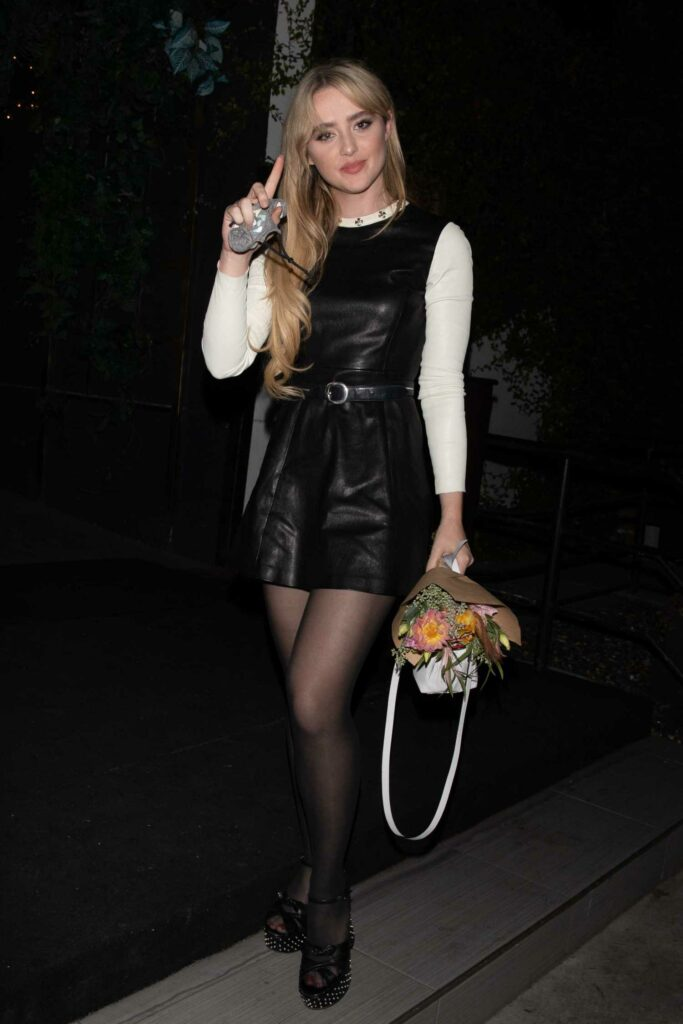 Kathryn Newton in a Black Leather Mini Dress