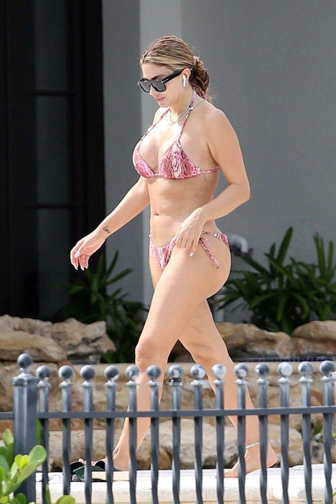 Larsa Pippen in a Pink Snakeskin Print Bikini