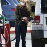 Meg Ryan in a White Protective Mask Buys Gas in Santa Monica