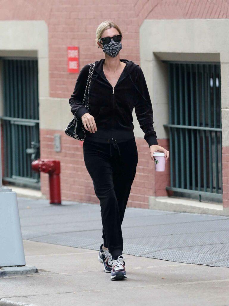 Nicky Hilton in a Black Tracksuit
