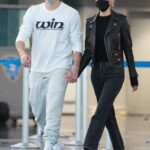 Nicola Peltz in a Black Cap Out with Brooklyn Beckham Arrives to JFK Airport in New York