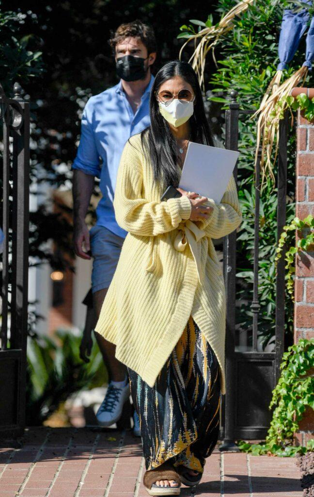 Nicole Scherzinger in a Yellow Cardigan