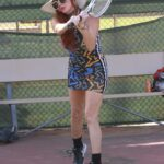 Phoebe Price in a Beige Hat Shows off Some Tennis Moves in Los Angeles