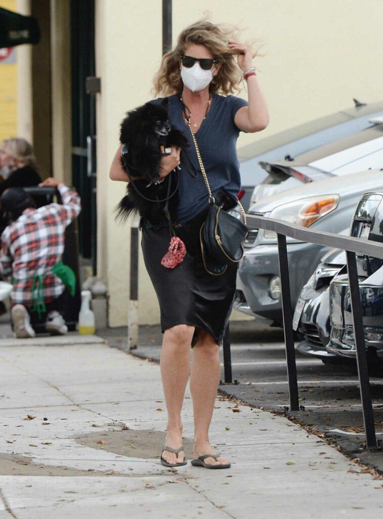Rachel Hunter in a Black Skirt