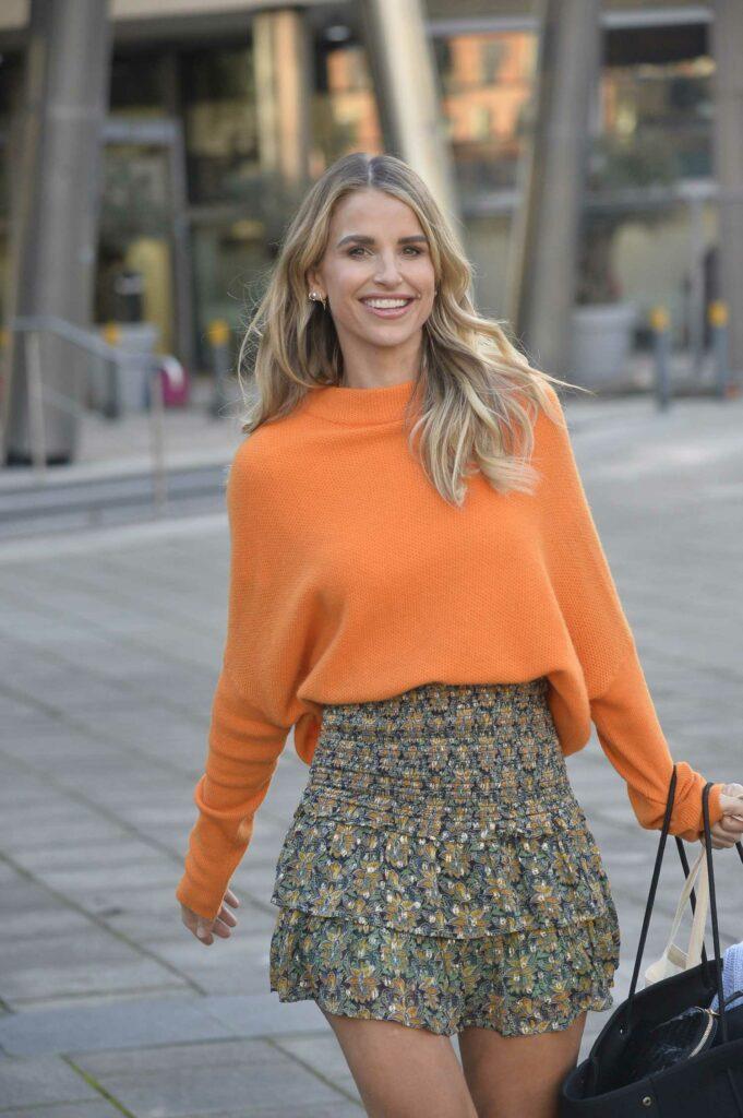 Vogue Williams in an Orange Sweater