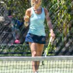 Britney Theriot in a Light Blue Tank Top Plays Tennis in Sydney