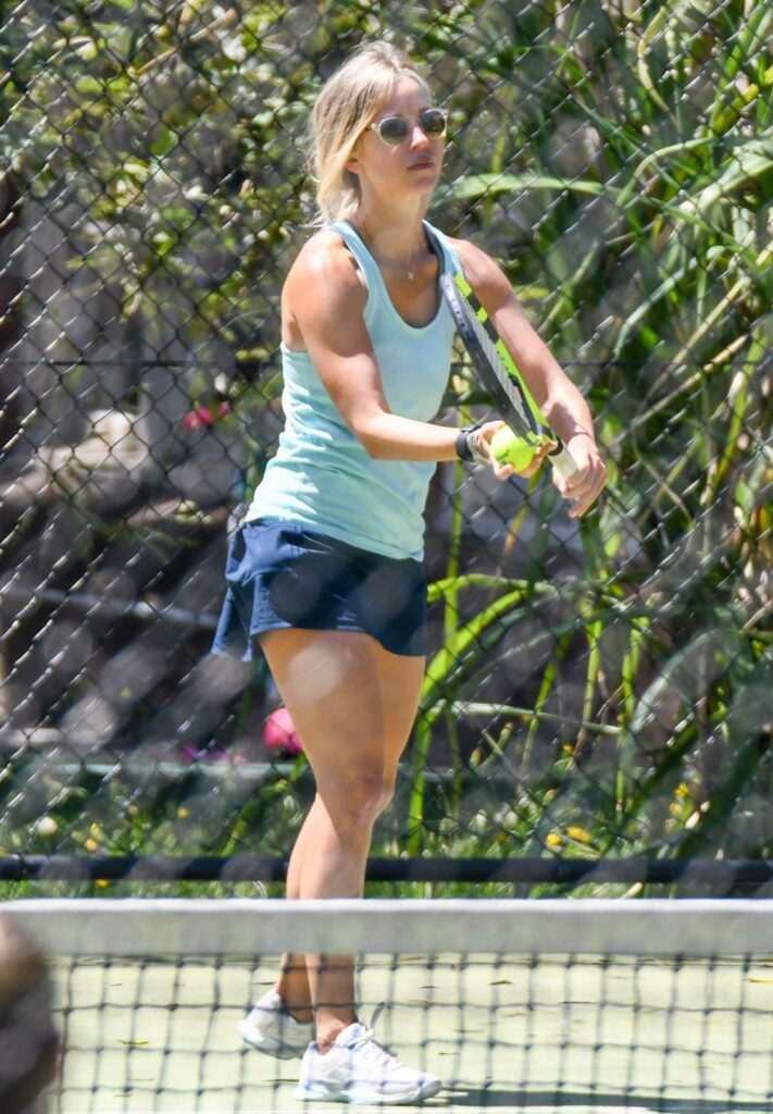 Britney Theriot in a Light Blue Tank Top