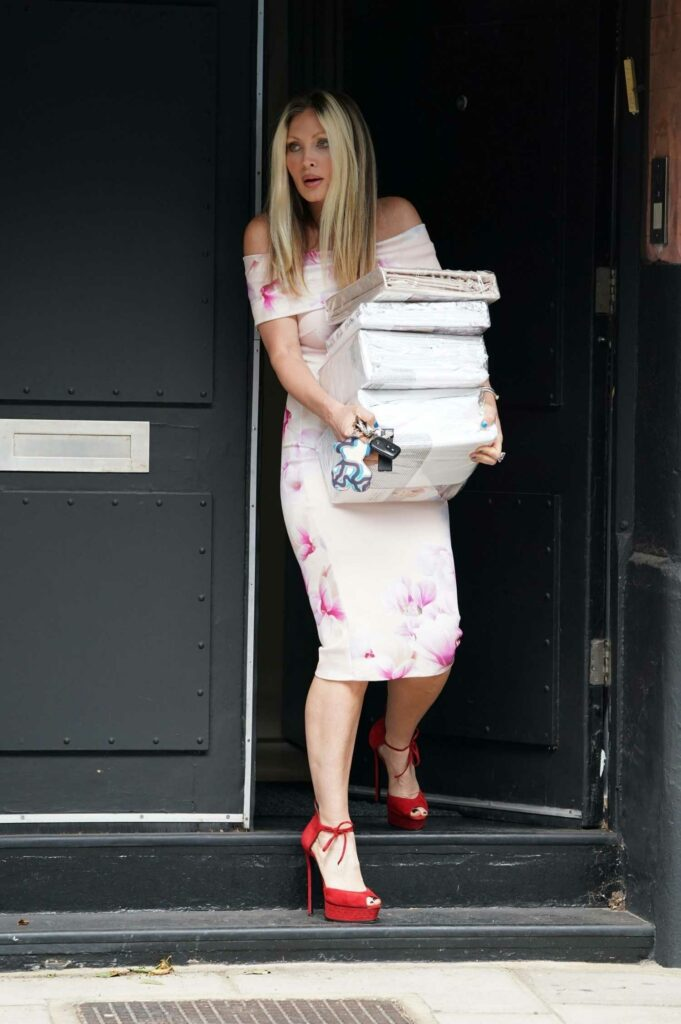Caprice Bourret in a Tightly Fitted Floral Dress