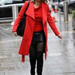 Charlotte Hawkins in a Red Coat Leaves the Global Radio in London