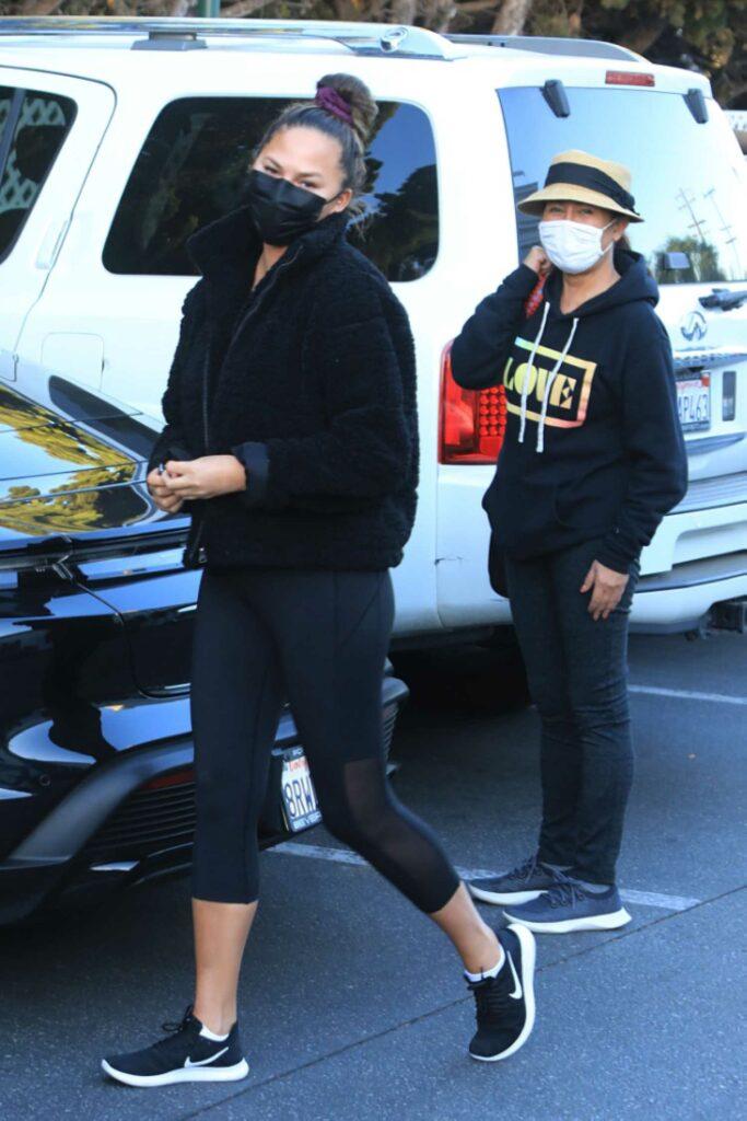 Chrissy Teigen in a Black Protective Mask