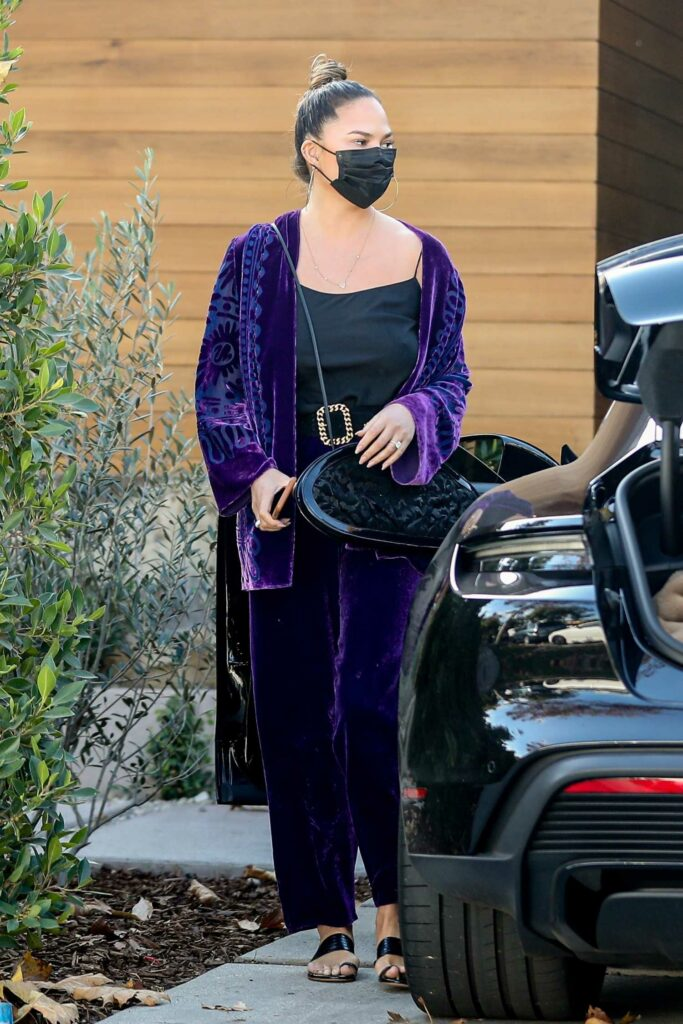 Chrissy Teigen in a Purple Ensemble