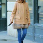 Olivia Palermo in a Beige Coat Walks Her dog Mr. Butler in New York