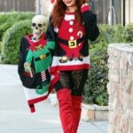 Phoebe Price in a Christmas Outfit Posing with a Skeleton in Los Angeles