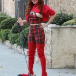 Phoebe Price in a Red Outfit Walks Her Dog Henry in Los Angeles