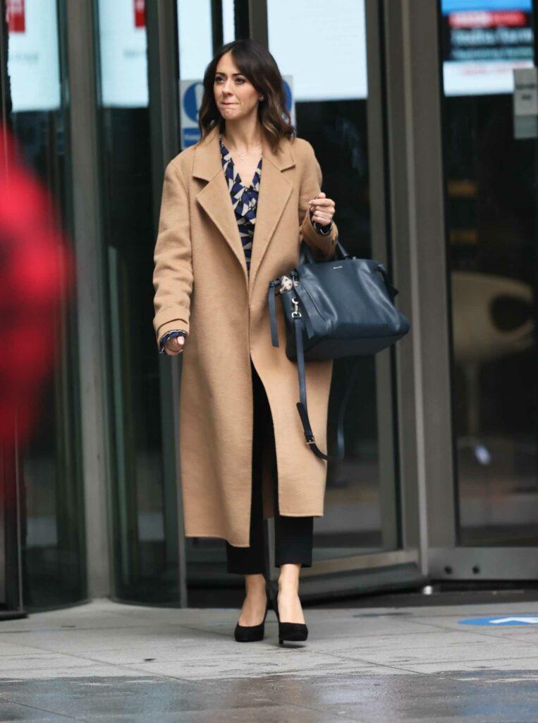 Susannah Fielding in a Tan Coat