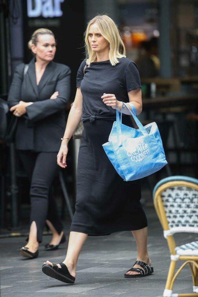 Sylvia Jeffreys in a Black Dress