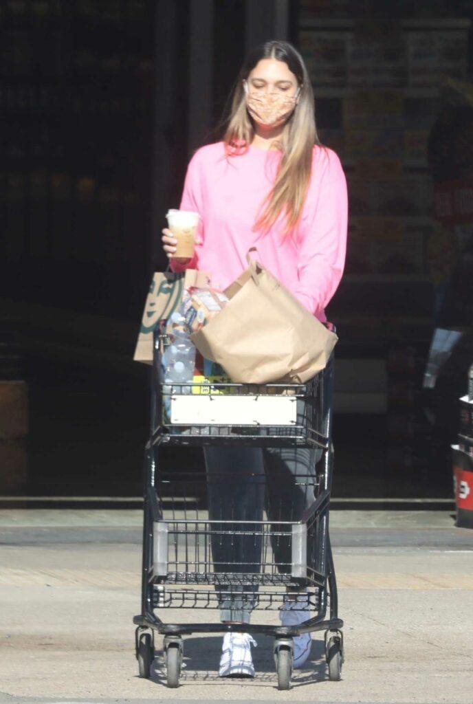 April Love Geary in a Pink Sweatshirt
