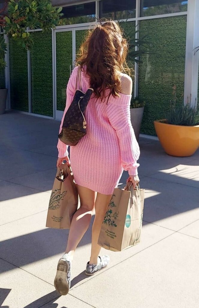Blanca Blanco in a Pink Sweater