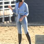 Chrissy Teigen in a Blue Denim Shirt Was Spotted During a Family Trip to Ride Horses in Malibu