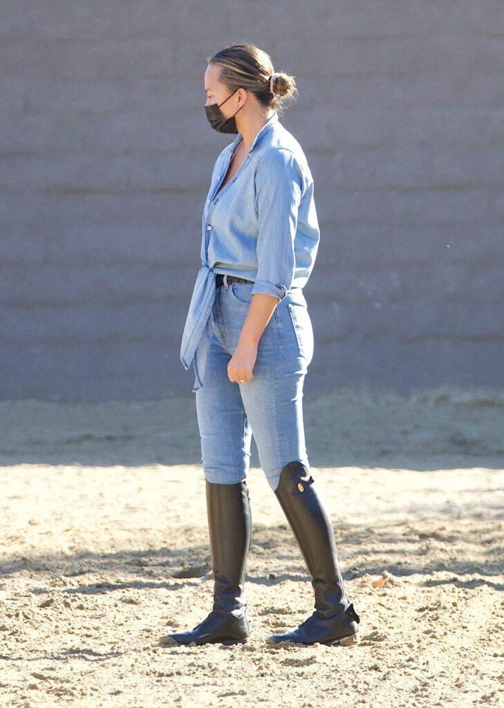 Chrissy Teigen in a Blue Denim Shirt
