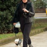 Daisy Lowe in a Black Sweatpants Walks Her Dog in North London