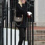 Denise Van Outen in a Black Hoodie Takes a Phone Call Outside Clinic in London
