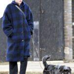 Emma Corrin in a Blue Plaid Coat Walks Her Dog in North London
