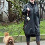 Kelly Brook in a Black Cap Walks Her Dog Teddy in London