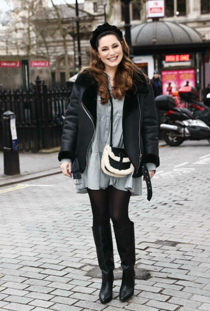 Kelly Brook in Grey Mini Dress