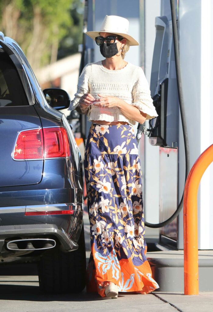 Laeticia Hallyday in a Floral Print Skirt