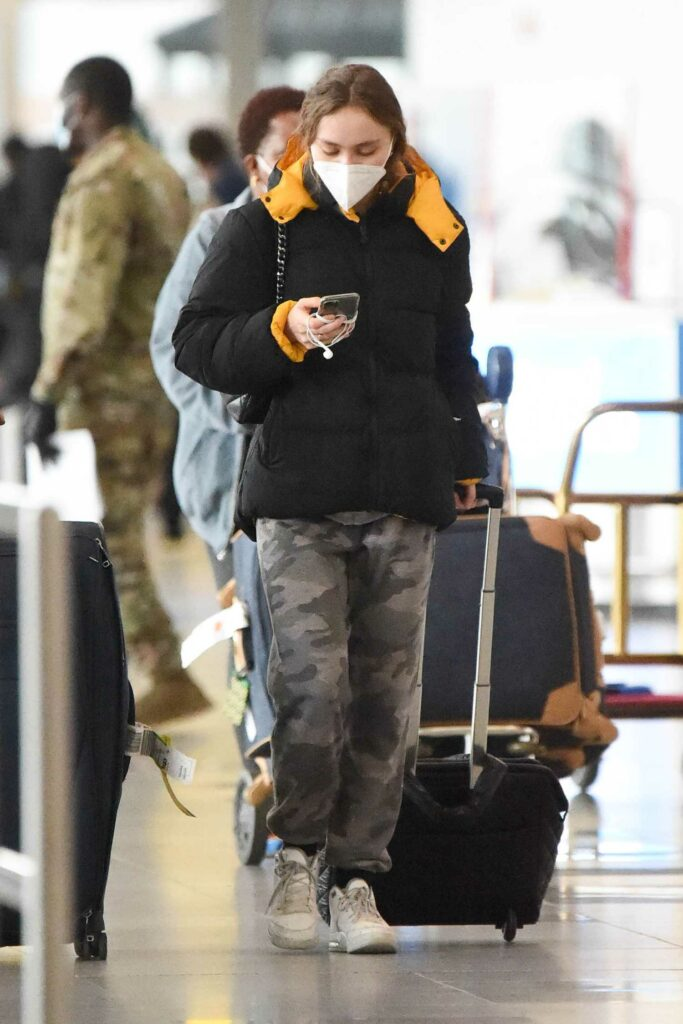 Lily-Rose Depp in a Black Puffer Jacket