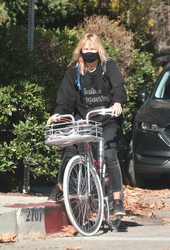 Malin Akerman in a Black Protective Mask