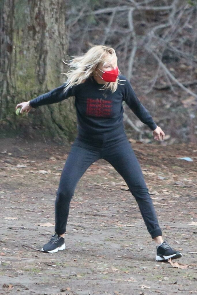 Malin Akerman in a Red Protective Mask