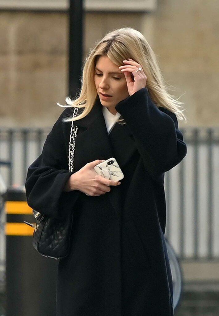 Mollie King in a Black Coat