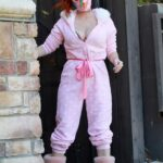 Phoebe Price in a Pink Polka Dot Jumpsuit Posing Near Her Home in Los Angeles