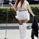Phoebe Price in a White Mini Skirt Walks Her Dog in Los Angeles