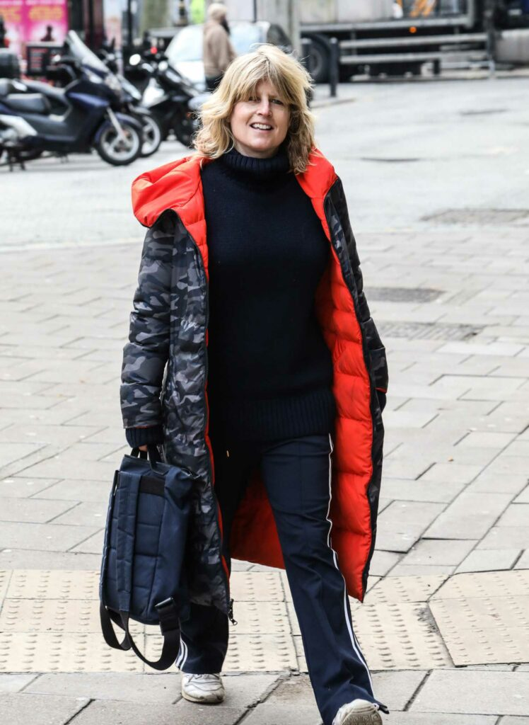 Rachel Johnson in a Grey Camo Puffer Coat