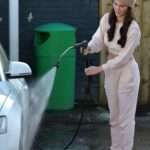 Rebecca Gormley in a Beige Beanie Hat Washes Chris Biggs Car Close to Her Home in Newcastle