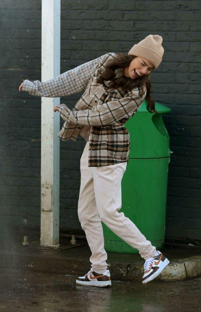 Rebecca Gormley in a Beige Beanie Hat
