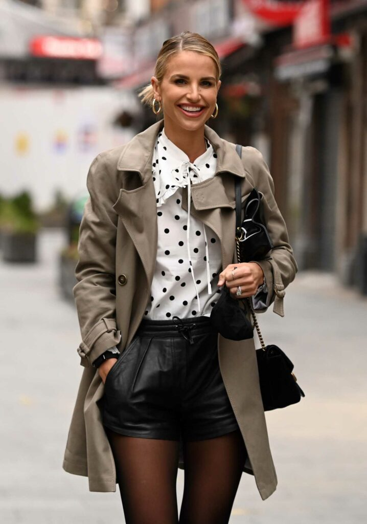 Vogue Williams in a White Polka Dot Blouse