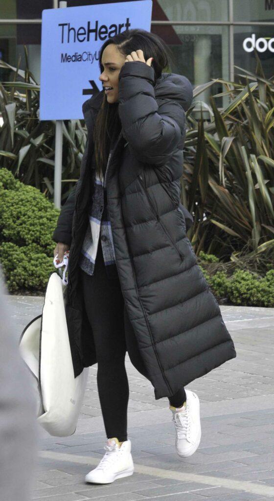 Alex Scott in a Black Puffer Coat