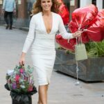 Amanda Holden in a White Dress Leaves the Heart Radio Ahead of Her 50th Birthday in London
