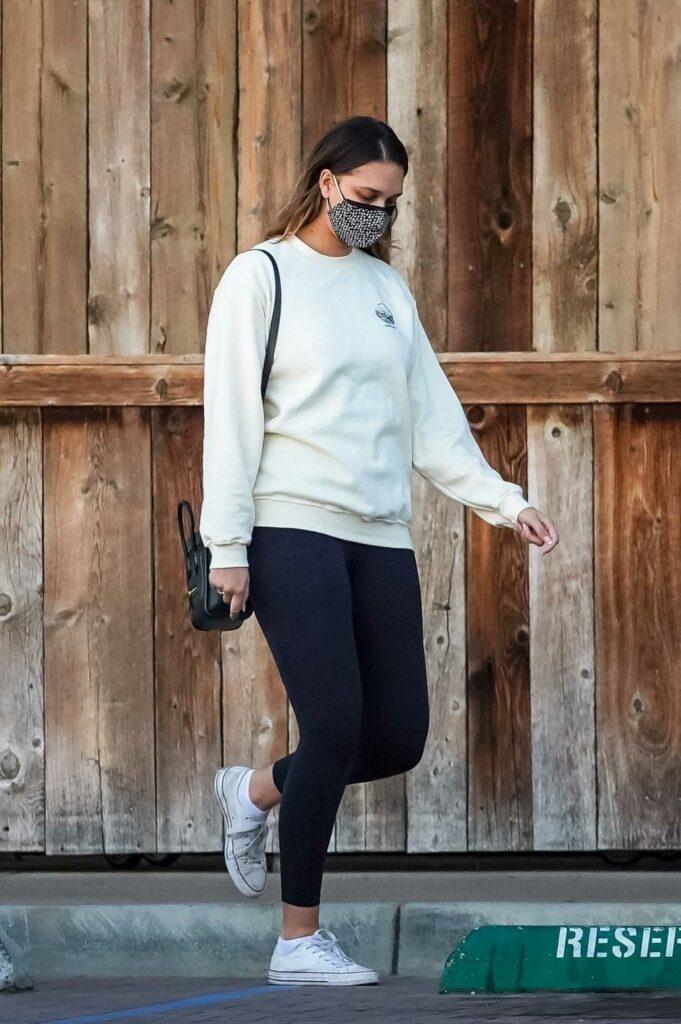 April Love Geary in a White Sweatshirt