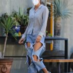 Brooke Burke in a Blue Ripped Jeans Heads to a Business Meeting in Beverly Hills