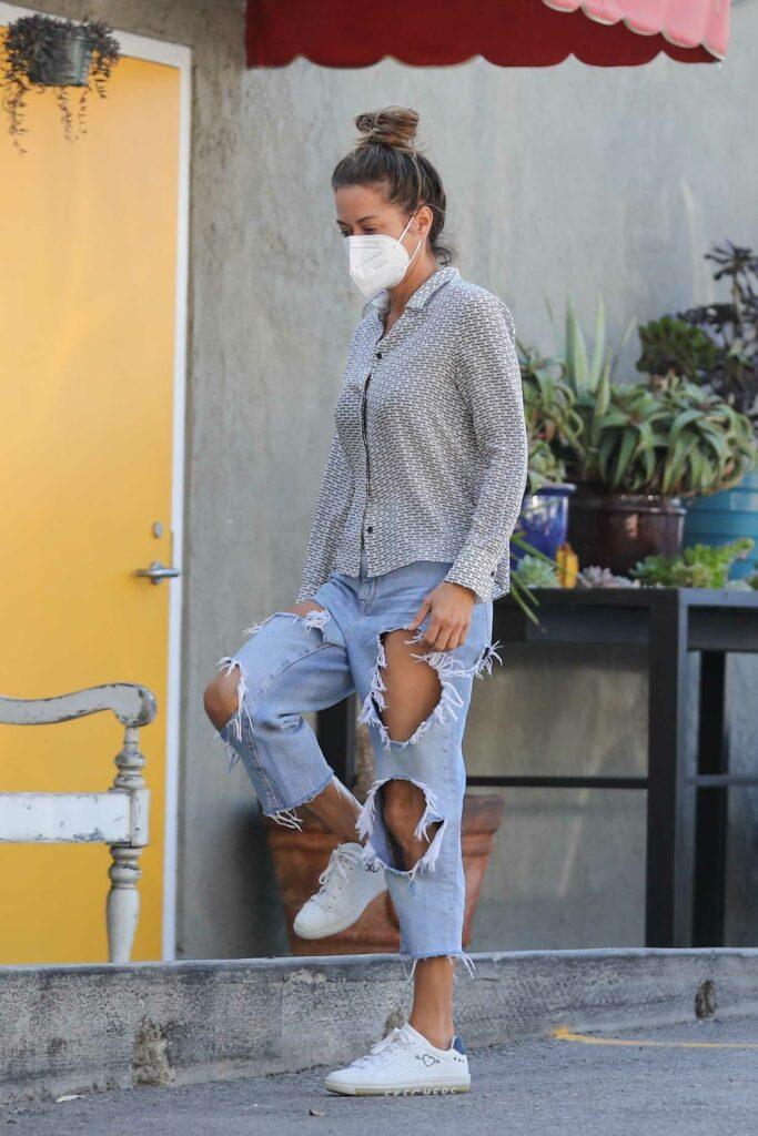 Brooke Burke in a Blue Ripped Jeans