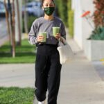Cara Santana in a Black Sweatpants Grabs Two Drinks from Cha Cha Matcha in West Hollywood
