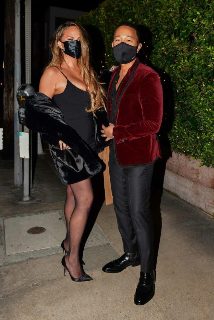 Chrissy Teigen in a Black Mini Dress