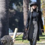 Diane Keaton in a Black Coat Walks Her Dog in Santa Monica
