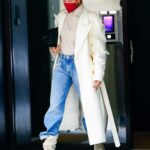 Hailey Bieber in a White Trench Coat Leaves the Studio in New York